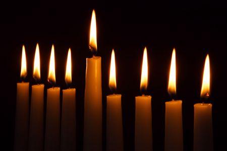 Hanukkah candles all candle light on the traditional Hanukkah menorah