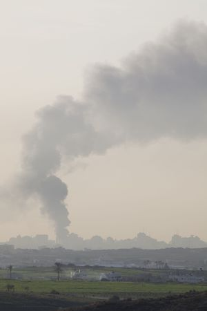 Israeli – Palestinian conflict. Israeli military operation Cast Lead. Smoke over Gaza strip after the Israeli army air strike 15/01/2009 Stock Photo - 4342654
