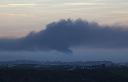 Israeli – Palestinian conflict. Israeli military operation Cast Lead. Smoke over Gaza strip after the Israeli army air strike 15/01/2009 Stock Photo - 4342617