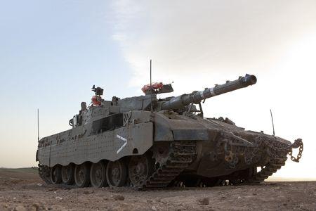 Israeli�Palestinian conflict. Israeli military operation Cast Lead. Israeli tank Merkava ( Mercava)  Mk 4 on border with Gaza strip photo