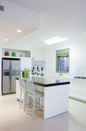 White  luxury kitchen in a  new modern home  photo