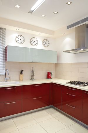 Luxury kitchen with red and marble elements photo