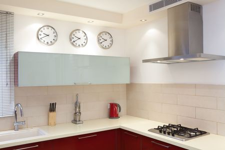 stainless steel kitchen: Luxury kitchen with red and marble elements