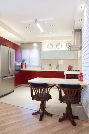 Luxury kitchen with red and marble elements Stock Photo - 7380527
