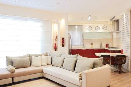 Modern design living room and kitchen white red and wood elements photo