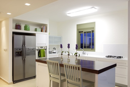 Modern design kitchen with white and wood elements photo