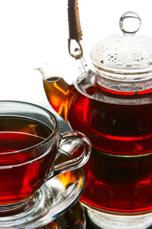 Tea service Teapot and cup of tea photo