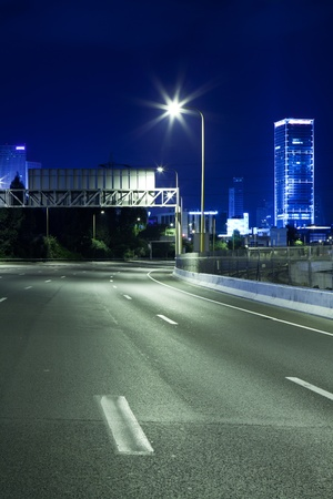 Empty freeway at night photo