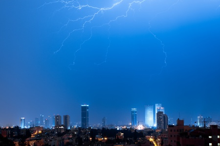 Panorama of the Tel Aviv with lightning over a city photo