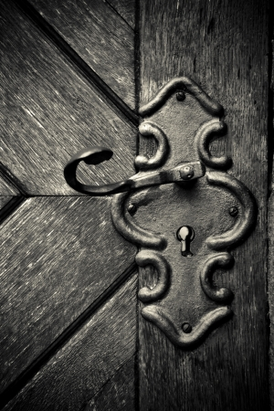 Close-up of an old medieval keyhole and door - Sepia Toned photo