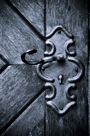 Close-up of an old medieval keyhole and door photo