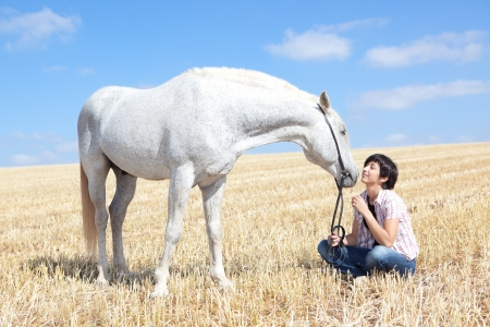 nature photography: Smiling Young Woman Posing With Her Horse