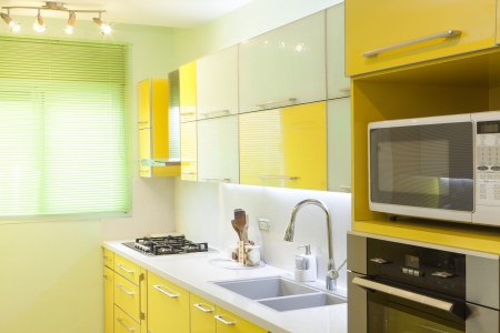 Modern design kitchen with yellow and green elements photo