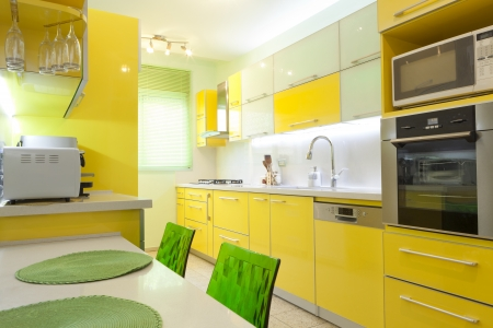 Modern design kitchen with yellow and green elements Stock Photo - 14447205