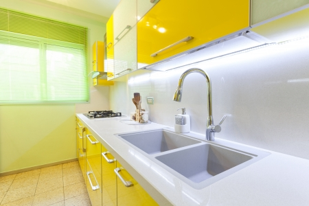 Modern design kitchen with yellow and green elements Stock Photo - 14447215