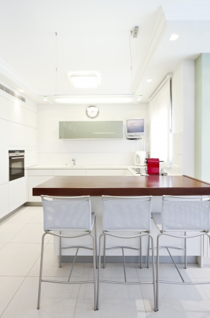 man made structure: Modern design kitchen with white elements  Note to reviewer: Original picture in the TV Screen  was replaced by one of my images. Stock Photo