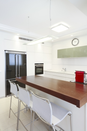 reviewer: Modern design kitchen with white elementsNote to reviewer  Original picture in the TV Screen  was replaced by one of my images  Stock Photo