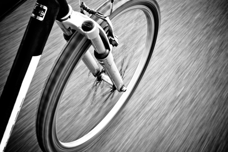 Bicycle in Motion on Road Black And White PhotographyShallow Focus Stock Photo - 19900262