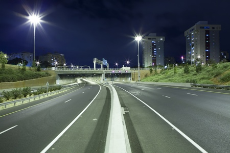 Empty freeway at night Stock Photo - 19900277