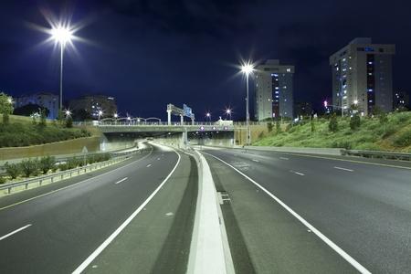 Empty freeway at night Stock Photo - 19900277