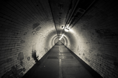 underworld: Empty tunnel at night - Light at the end of  tunnel  - Sepia Toning Stock Photo