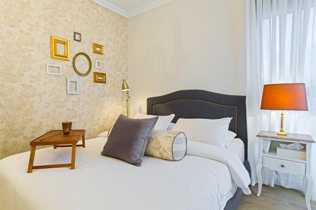 luxury hotel room: Modern luxury bedroom with wallpaper    Luxury Hotel Room Stock Photo