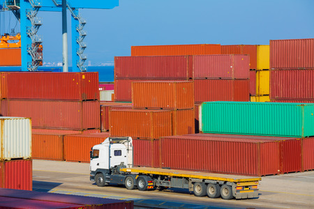 intermodal: Cargo freight shipping containers at the docks � storage area in the sea port Stock Photo