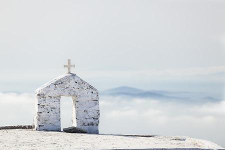 urban idyll: Greek church on the high mountain, Tinos, Greece. Amazing landscape of Tinos.