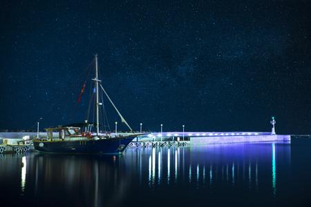 sail boat: Sail boat in harbor at starry night,