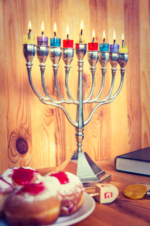 hanukka: Jewish Holiday Hanukkah With Menorah, Torah, Donuts And Wooden Dreidels