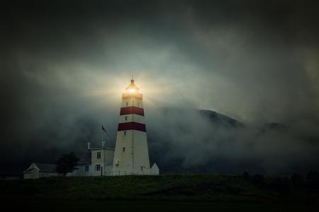 Lighthouse at foggy day, Fishing Village In Godoya Island - Godøy Island - Giske, Romsdal county, Norway.