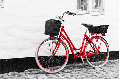 cobblestone street: Retro vintage red bicycle on cobblestone street in the old town. Black And White Toned. Ribbe, Denmark Stock Photo