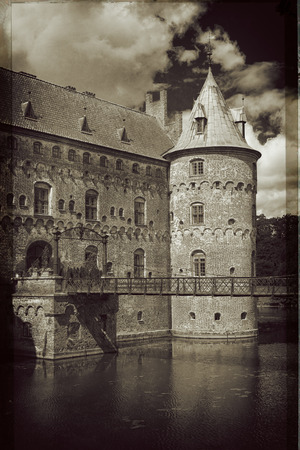 Egeskov Castle, located in the south of the island of Funen, Denmark. Vintage look. Editorial
