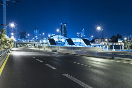 yom kipur: Empty freeway at night And Tel Aviv Skyline in Background Stock Photo