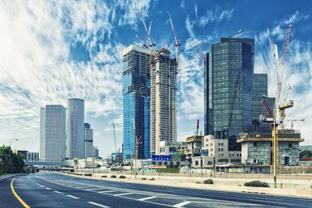 Tel Aviv Cityscape In Daylight, New Skyscraper Constraction Site and Empty Aylon Freeway.