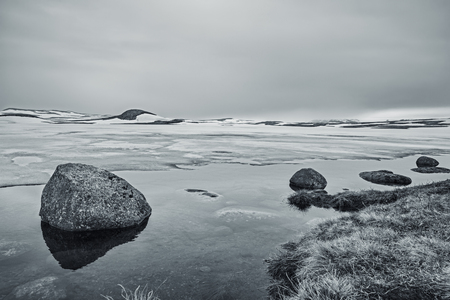 Rocks In A Lake, An Overcast Day At The Lake, Winter Landscape, Norway  Standard-Bild