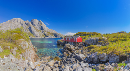 Red Classic Norwegian Rorbu fishing hut on Lofoten islands, Norwegian traditional type of house used by fishermen