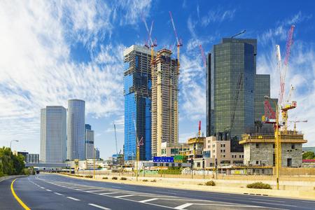 Tel Aviv Cityscape In Daylight, New Skyscraper Under Constraction and Empty Aylon Freeway.