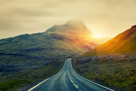 A long straight Country Road, Faroe Islands Standard-Bild - 105398033