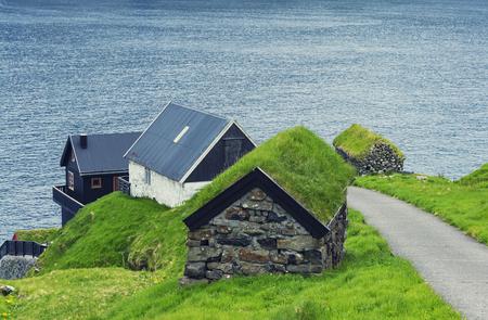 Beautiful  Scene Of Mikladalur village, located on the island of Kalsoy, Faroe Islands Standard-Bild - 105374101