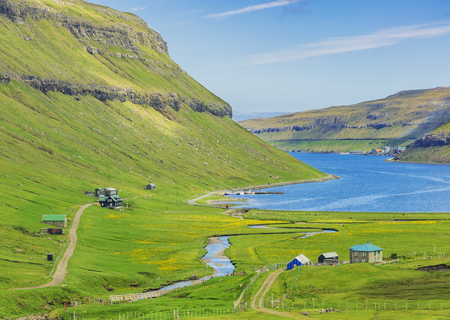 Beautiful Scene Of Faroe Islands, Typical Scandinavian Houses Near Fjord In Faroe Islands Standard-Bild