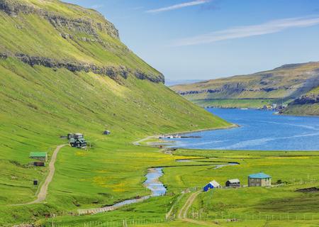 Beautiful Scene Of Faroe Islands, Typical Scandinavian Houses Near Fjord In Faroe Islands Standard-Bild - 105398040