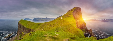 Shot Of Beautiful Panoramic Scene, Sunrise Over Kalsoy Island and Kallur lighthouse, Faroe Islands Standard-Bild