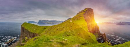 Shot Of Beautiful Panoramic Scene, Sunrise Over Kalsoy Island and Kallur lighthouse, Faroe Islands Standard-Bild - 105398041