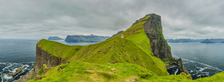 Shot Of Beautiful Panoramic Scene, Kalsoy Island and Kallur lighthouse, Faroe Islands Standard-Bild - 105397967