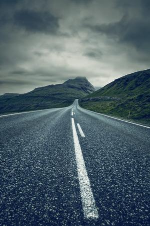 A long empty straight Road, Faroe Islands Standard-Bild - 105397968