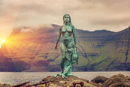 Kalsoy Island, Faroe Islands -JUNE 2018: Statue of Kopakonan (the Seal Woman), Mikladalur village, Faroe Islands Editorial