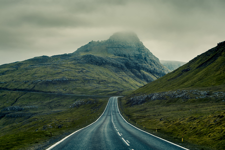 A long straight Country Road, Faroe Islands Standard-Bild - 105397979