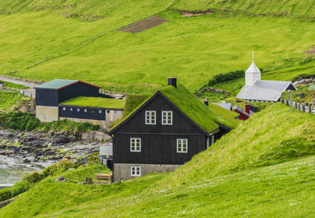 Scandinavian House with green roof, Faroe Islands