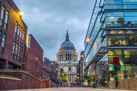St Paul's Cathedral in Twilight with Moving People in London, UK